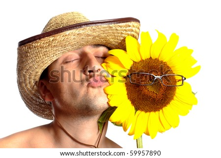 Funny fermer in stetson with sunflower in glasses isolated on white. Close up portrait - stock photo