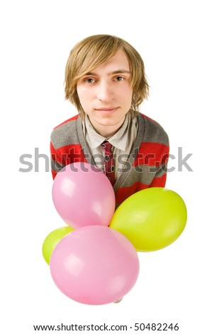 Funny fisheye portrait of young man with balloon - stock photo