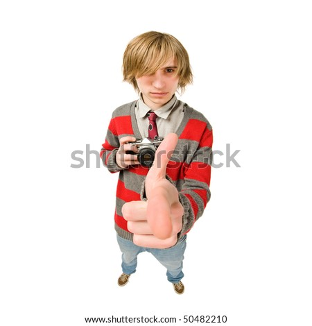 Funny fisheye portrait of young man with retro camera - stock photo