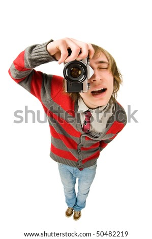 Funny fisheye portrait of young man with retro camera
