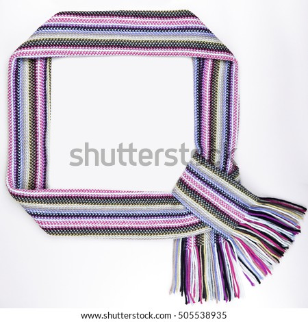 Funny frame made of warm scarf