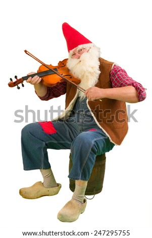 Funny garden gnome playing on a violin - stock photo