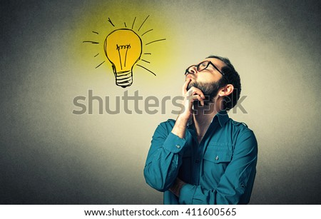 funny geek with glasses has an idea - stock photo