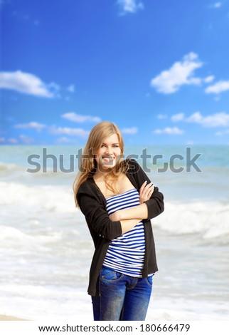 Funny girl at outdoor near sea. - stock photo