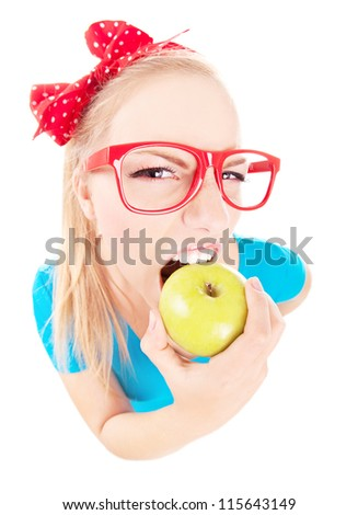 Funny  girl biting an apple isolated on white, fish eye lens shot - stock photo