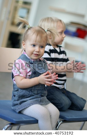 Funny girl claps and sings - stock photo