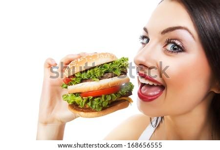 funny girl eating hamburger on white background  - stock photo