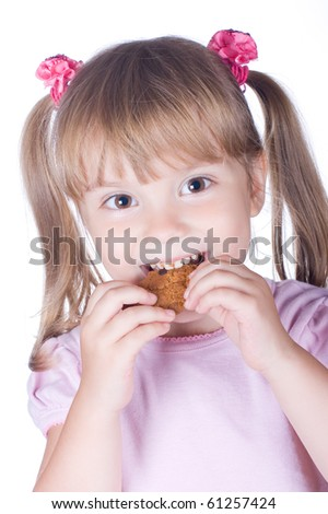 Funny girl eats oatmeal biscuits - stock photo