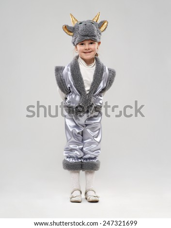 funny girl in cow costume - stock photo