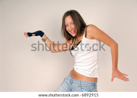 funny girl in white blouse and black glove on the white background