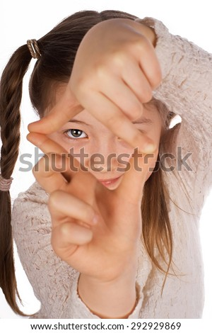 Funny girl, making frame with hands, taking picture with imaginary camera, selective focus - stock photo