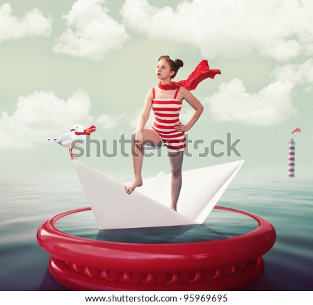 Funny girl on the paper boat in the sea. Digitally generated image. Tonalities & grain are added./Queen of the Sea - stock photo