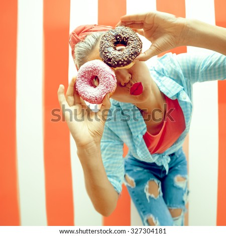 Funny Girl Retro Pin-up style with Donuts - stock photo