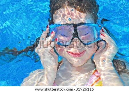 Funny girl under water with mask on - stock photo