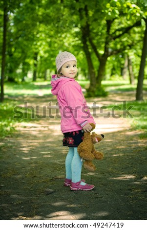 funny girl with bear toy - stock photo