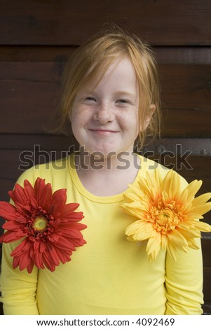 funny girl with big colored flowers