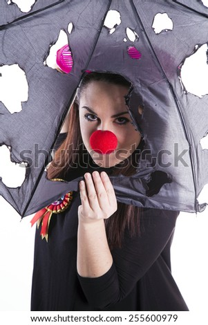 funny girl with clown nose - stock photo