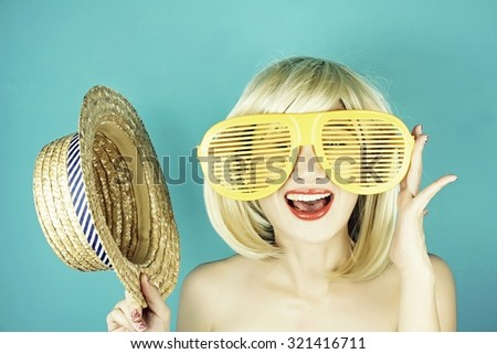 Funny girl with funny glasses, Happy naughty blonde hair woman with giant sunglasses. Woman in crazy clown glasses, Large funny glasses. (Vintage Style Color) - stock photo