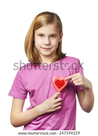 Funny girl with lollipop hearts isolated - stock photo