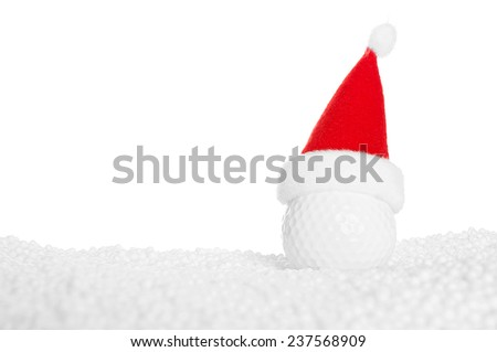 Funny golf-ball with Santa-hat in a snowy landscape isolated over white - stock photo