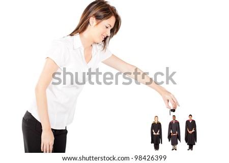 funny graduation - young woman putting graduation cap on graduates - stock photo