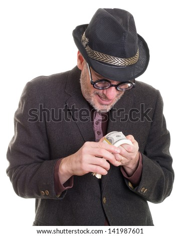 Funny greedy man counting his money - stock photo
