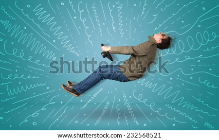 Funny guy drives an imaginary vehicle with drawn lines around him concept - stock photo