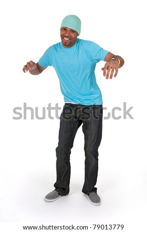 Funny guy in a blue t-shirt dancing, isolated on white background. - stock photo