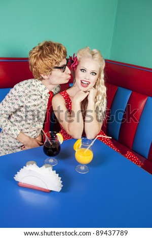 Funny guy kissing a girlfriend, similar available in my portfolio - stock photo
