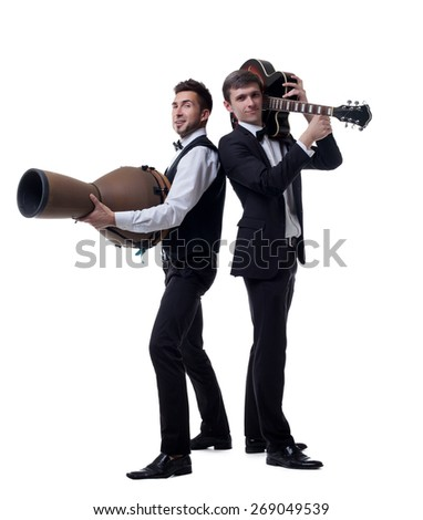 Funny guys posing with musical instruments - stock photo