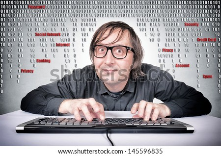Funny hacker in action on his keyboard - stock photo