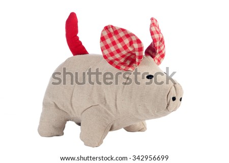 Funny handmade toy pig isolated on white, Pattern Fabric - stock photo
