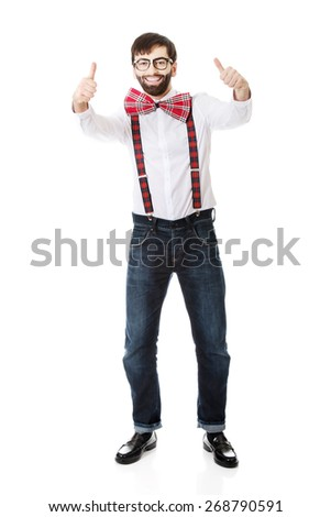 Funny handsome man wearing suspenders with ok sign. - stock photo