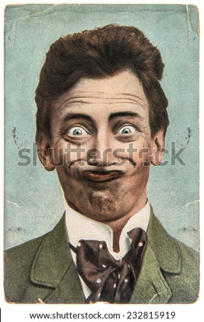 funny handsome man with crazy smile. vintage aged paper picture - stock photo