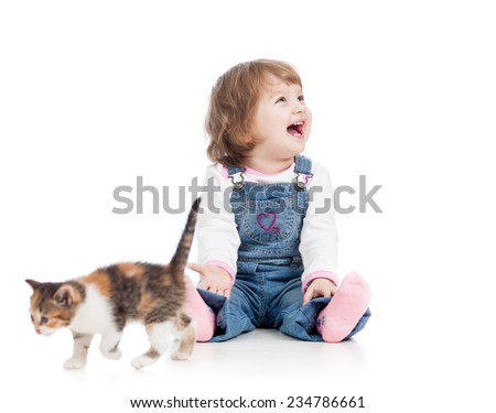 funny happy child girl playing with cat kitten - stock photo