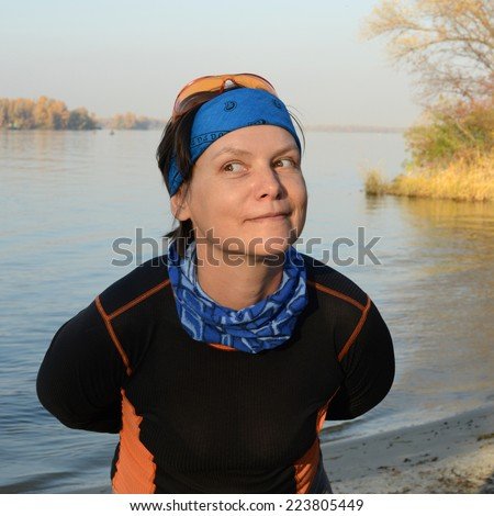 Funny hiker on the beach - stock photo