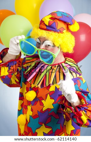 Funny hip hop clown with oversized shades shaking his finger. - stock photo