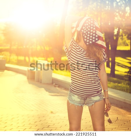 Funny Hipster Girl with USA Flag on her Head. Toned and Filtered Instagram Styled Photo. Modern Youth Lifestyle Concept. - stock photo