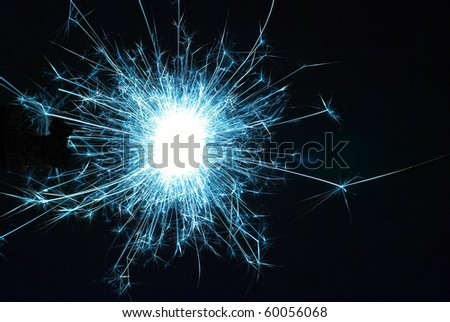 Funny holiday sparkle on the black background - stock photo