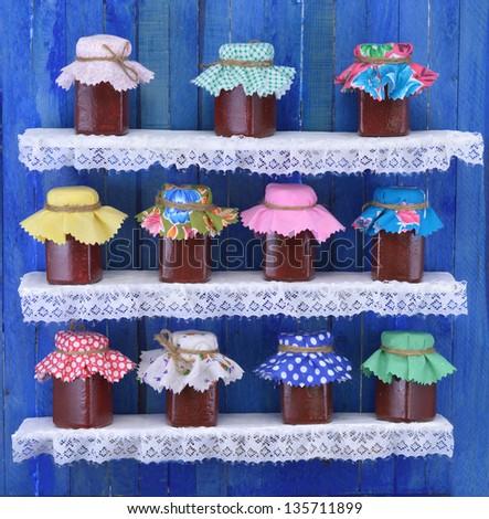Funny homemade jars with jam - stock photo