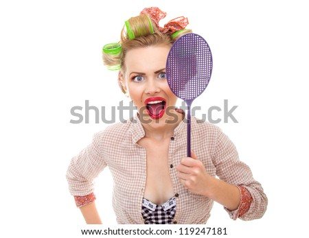 Funny housewife / girl with fly swatter, isolated on white. Close-up - stock photo