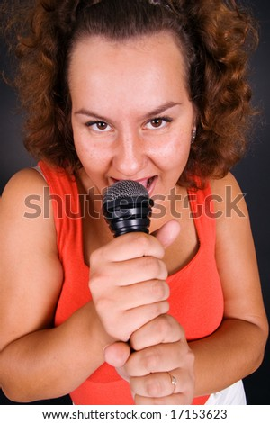 funny housewife singing at karaoke - stock photo