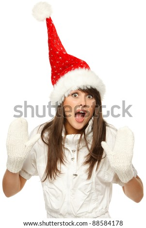 Funny image of a girl in red santa hat shocked and surprised, isolated on white background - stock photo