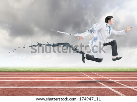 Funny image of doctor running at stadium - stock photo