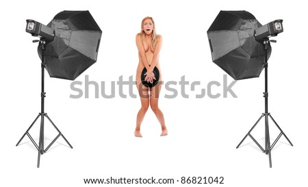 Funny image of prude nude showgirl in studio. - stock photo