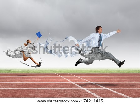 Funny image of young businesspeople running at stadium - stock photo