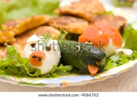 funny infant food - egg and cucumber designed like animals - stock photo