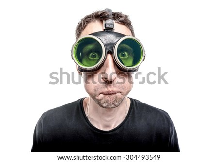 Funny inflated cheeks nerdy guy in green vintage goggles. - stock photo
