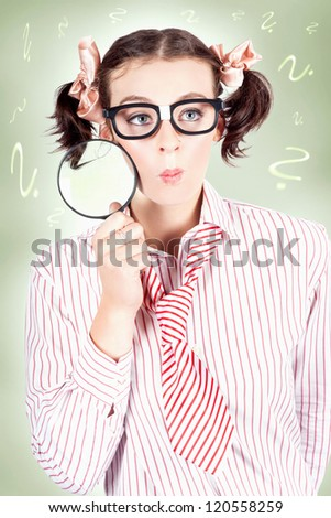 Funny Inquisitive Schoolgirl Wearing Nerd Glasses While Thinking Smart With Magnifying Glass - stock photo