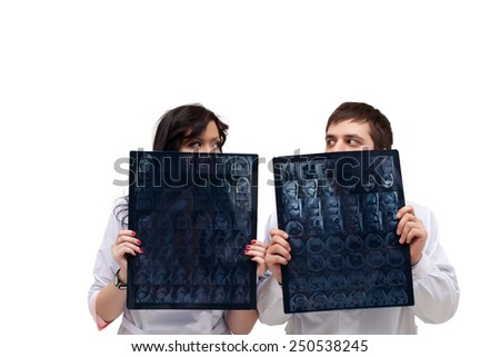 Funny interns look out of tomograms - stock photo